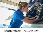 female aero engineer working on ... | Shutterstock . vector #733645624