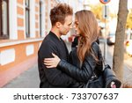 stylish young couple in a black ... | Shutterstock . vector #733707637