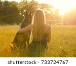 blurred silhouette of a blonde... | Shutterstock . vector #733724767