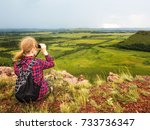 the girl sits on the mountain... | Shutterstock . vector #733736347