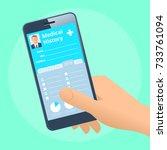 human hand holds smart phone... | Shutterstock .eps vector #733761094