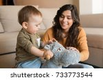 baby boy playing with a rocking ...   Shutterstock . vector #733773544