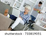 senior injured woman using... | Shutterstock . vector #733819051