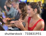 woman celebrating win on slot... | Shutterstock . vector #733831951