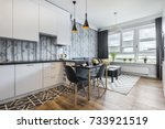Modern small room with  kitchen area and wooden floor