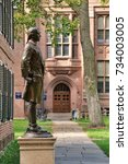 Small photo of YALE UNIVERSITY, NEW HAVEN, CONNECTICUT, USA - OCTOBER 2017: Bronze Nathan Hale statue on the old campus quadrangle at Yale. Americas first spy who was caught and executed by the British
