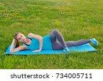 a woman in a blue t shirt doing ...   Shutterstock . vector #734005711
