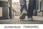 feet walking street  | Shutterstock . vector #734034901