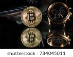 watches with bitcoin close up... | Shutterstock . vector #734045011