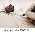 Small photo of write a love letter with a rose over pink background