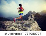 fitness woman trail runner... | Shutterstock . vector #734080777