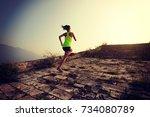 fitness woman trail runner... | Shutterstock . vector #734080789