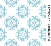 blue floral design on white... | Shutterstock .eps vector #734081251