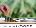 hand holding coin  stack of... | Shutterstock . vector #734085259