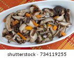 Small photo of Cooked Mushrooms Shiitake in cast iron pan. Bioproduct cultivation in natural environment. Selective focus