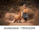a little girl with a fox in... | Shutterstock . vector #734121244