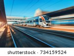 high speed train in motion at... | Shutterstock . vector #734159524