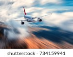 airplane with motion blur... | Shutterstock . vector #734159941