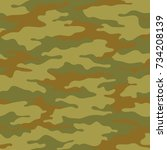 seamless camouflage pattern.... | Shutterstock .eps vector #734208139