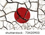 Cracked soil as Japan flag to symbolize the recent earthquake and calamity that struck this country - stock photo
