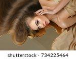 girl with beautiful long hair   Shutterstock . vector #734225464