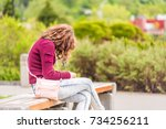 one young happy woman sitting... | Shutterstock . vector #734256211