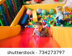 boys playing on the playground  ... | Shutterstock . vector #734273797