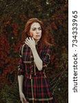 outdoor beautiful red hair girl ... | Shutterstock . vector #734333965