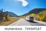 camper on road trip on road - stock photo