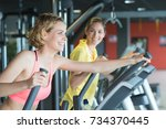 personal trainer with female... | Shutterstock . vector #734370445