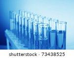 test tubes on blue background | Shutterstock . vector #73438525