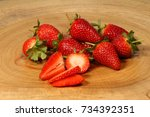 strawberries lying on a wooden... | Shutterstock . vector #734392351