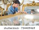 female artisan working on a big ... | Shutterstock . vector #734409469