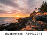 acadia lightouse at sunset with ... | Shutterstock . vector #734413345