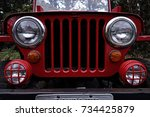red jeep   antique jeep grille... | Shutterstock . vector #734425879