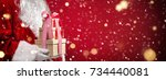 santa claus holding gift boxes... | Shutterstock . vector #734440081