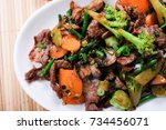 spicy beef stir fry with... | Shutterstock . vector #734456071