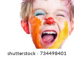yelling small boy with painted... | Shutterstock . vector #734498401