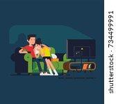 couple watching sad drama movie.... | Shutterstock .eps vector #734499991