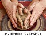 hands of two people create pot...   Shutterstock . vector #734502475