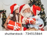 santa claus with kids indoors... | Shutterstock . vector #734515864