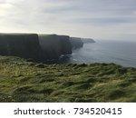 the beautiful cliffs of moher... | Shutterstock . vector #734520415