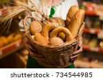 woman holding bread in basket... | Shutterstock . vector #734544985