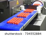 forming sausages from minced... | Shutterstock . vector #734552884