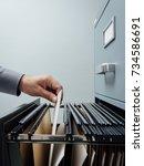 office clerk searching for... | Shutterstock . vector #734586691