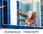 a little girl looks at her... | Shutterstock . vector #734624695