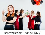 sad faced woman with glass of... | Shutterstock . vector #734634379