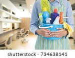woman with cleaning equipment... | Shutterstock . vector #734638141