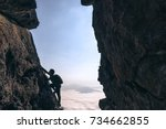 young climber man looking up... | Shutterstock . vector #734662855