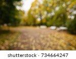 bokeh background of autumn town ... | Shutterstock . vector #734664247